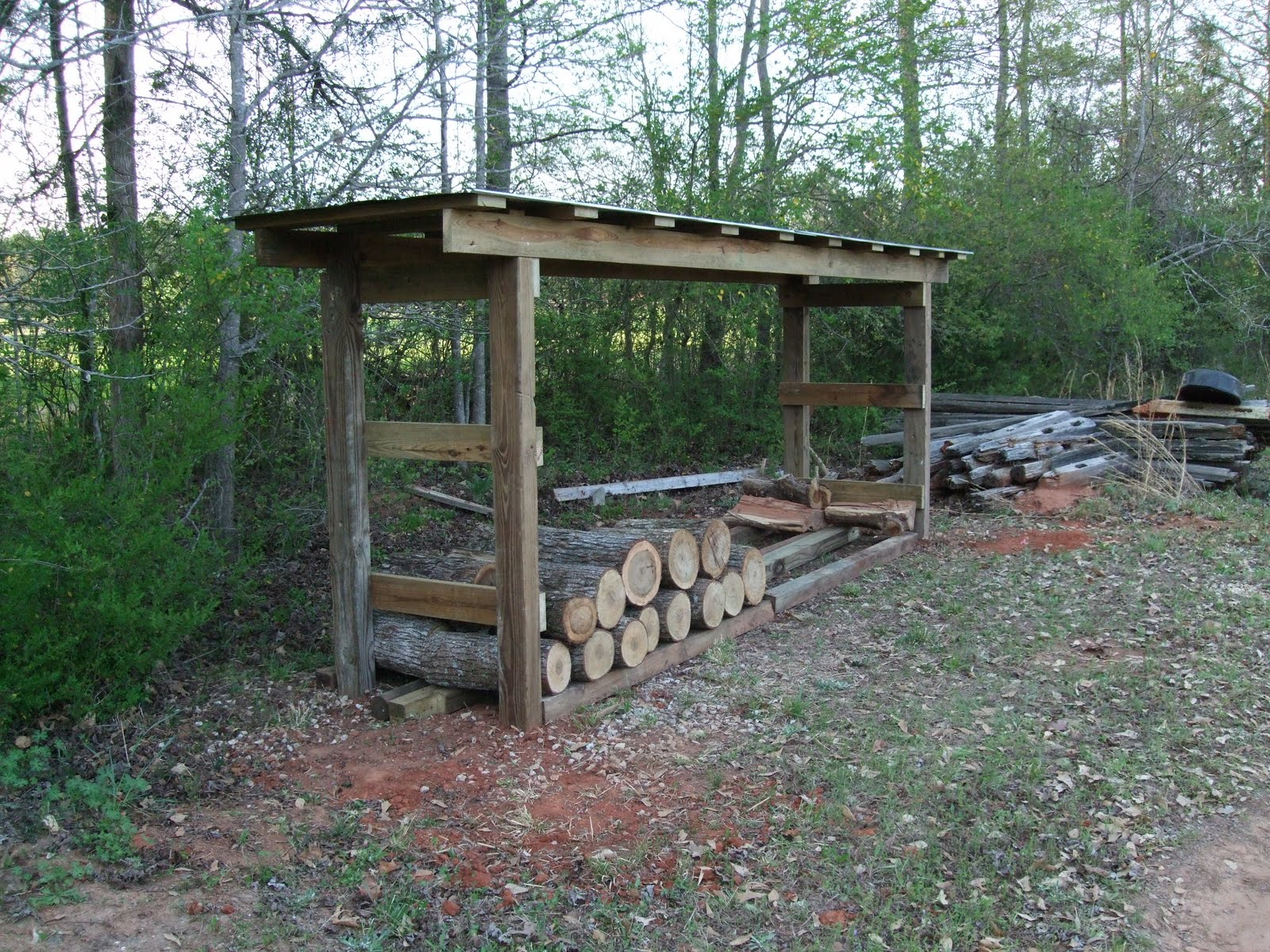 Firewood sheds plans how to build a pole barn from for Wood shed plans